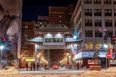 BOSTON, MASSACHUSETTS - JANUARY 03, 2014: Boston Cityscape with Entrance of China Town. Long Exposure Night Photography. Royalty Free Stock Photo