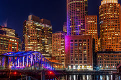 BOSTON, MASSACHUSETTS - JANUARY 03, 2014: Boston Cityscape with River Bridge. Long Exposure Night Photography. Royalty Free Stock Photo