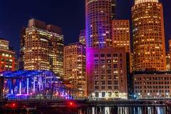 BOSTON, MASSACHUSETTS - JANUARY 03, 2014: Boston Cityscape with River Bridge. Long Exposure Night Photography. Royalty Free Stock Photos