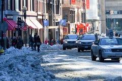 BOSTON, MASSACHUSETTS - JANUARY 04, 2014: Snowy Street in Boston royalty free stock photos