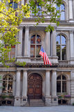 Boston Massachusetts Old City Hall. Front full frame of the entrance to Boston's historic Old City Hall, American flag resting over its doors Stock Image