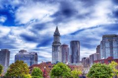 Boston Massachusetts Skyline cloudy day. The various buildings in the city of Boston Massachusetts cityscape on a cloudy, autumn blue sky day royalty free stock images