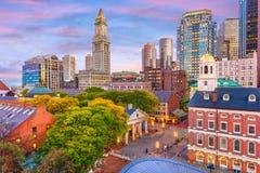 Boston, Massachusetts, USA Skyline. Boston, Massachusetts, USA downtown skyline over Faneuil Hall and Quincy Market at dusk royalty free stock photos