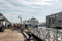 04.09.2017 Boston Massachusetts USA- People everyday life families and boats moored pier long wharf center of Boston stock images