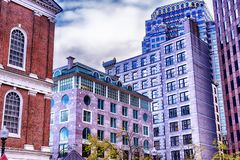 Boston Massachusetts various architecture cloudy day. The various buildings in the city of Boston Massachusetts cityscape on a cloudy blue sky day royalty free stock images