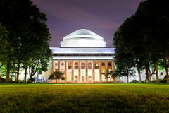 Boston MIT campus. Boston Massachusetts Institute of Technology campus with trees and lawn at night Royalty Free Stock Photos