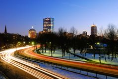 Boston at night. Traffic on Storrow Drive going in and out downtown Boston. John Hancock Tower on background Royalty Free Stock Image