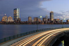 Boston at night from Cambridge. Twilight view of Boston skyline from Cambridge, Massachusetts. Memorial Drive and Charles river on forground Stock Image