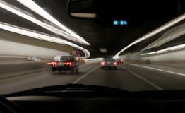 Boston Night Highway. Streaked highway lights in a tunnel in Boston, Massachusetts, USA taken from inside a moving car royalty free stock photos