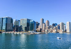 BOSTON - OCTOBER 2015: City port and buildings on a sunny day. B. Oston attracts 10 million people annually Royalty Free Stock Photography