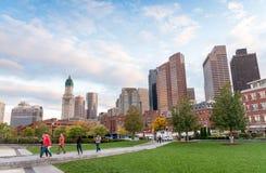 BOSTON - OCTOBER 18, 2015: Tourists walk along city park. Boston royalty free stock image