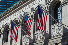 Boston Public Library. Exterior view of Boston Public Library from Copley Square. US Flags wave in the wind Stock Image