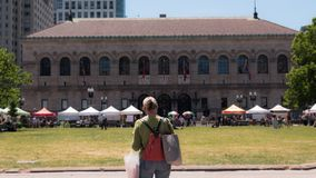 The Boston Public library with a Farmer`s Market royalty free stock photo