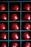 Boston Red Sox Baseball Helmets. Baseball helmets waiting for the players to use their helmets. These helmets are to be worn by the Boston Red Sox team for Stock Photo