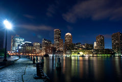 Boston's waterfront area at night in horizontal Royalty Free Stock Images