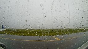 The plane is delayed at the airport Boston Logan International flies through a thunderstorm during the rain