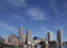 Boston skyline. Panorama showing skyscrapers and buildings by the waterfront Stock Photos