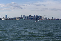 Boston Skyline with airplane landing Stock Photography