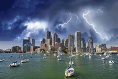 Free Boston Skyline And Boats Under A Coming Storm, Massachusetts Stock Photography - 199917432