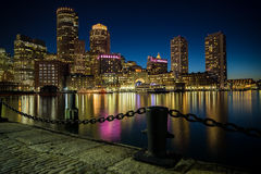 Boston skyline as seen from Fan Pier Park in Boston, MA. BOSTON, MA - MAY 16: Night time view of the skyline as seen from Fan Pier Park on May 16, 2016 in Stock Photos