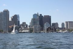 Boston Skyline As Seen From the Middle of the Harbor. A day in early fall clear blue skies and the skyline of Boston as see from the middle of the Boston Harbor stock photography