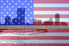 Boston skyline and Charles River. And American flag montage royalty free stock photography
