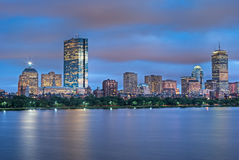 Boston Skyline at Dusk Across the Charles. Night view of the Boston Skyline with brightly illuminated buildings Royalty Free Stock Image