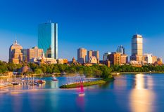Boston skyline at the evening. Cityscape of Back Bay Boston. Skyscrapers and office buildings reflected in the water of Charles River stock photography