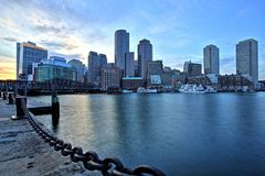 Boston Skyline with Financial District and Boston Harbor at Sunset. In USA royalty free stock images