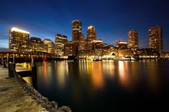 Boston Skyline with Financial District and Boston Harbor at Dusk. USA stock photos