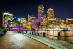 The Boston skyline and Fort Point Channel at night, in Boston, M Stock Photo