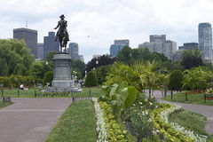 Boston skyline with George Washington Monument. Path leading to the George Washington monument in the Boston Commons. Skyline can be seen in distance. Surrounded Royalty Free Stock Photo