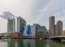Boston skyline from harbor on water stock photo