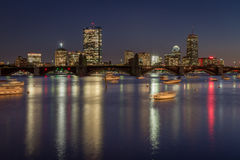 Boston skyline and the Longfellow bridge at night. View of downtown Boston a calm fall day. Long exposure to capture the vibrant city reflection in the Charles Royalty Free Stock Photo