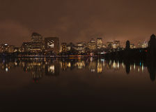 Boston skyline at night from Cambridge. With MIT bridge in the foreground stock images