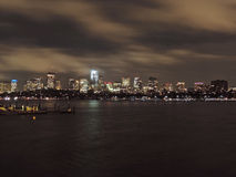 Boston Skyline at Night. The Downtown and Back Bay skylines of Boston as seen from Cambridge across the Charles River at Night stock photography