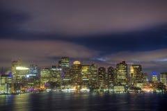 Boston Skyline at Night. The Boston skyline reflecting on the inner harbor at night Royalty Free Stock Photo