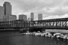 Boston skyline and Northern Avenue Bridge. Built in 1908. BOSTON,MASSACHUSETTS,USA - JULY 14,2016: Boston skyline and Northern Avenue Bridge. Built in 1908, it Royalty Free Stock Image