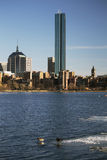 Boston Skyline and Prudential building in winter on half-frozen Charles River, Massachusetts, USA Stock Photos