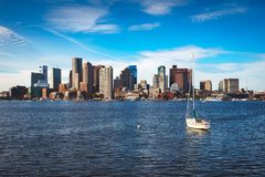 Boston skyline with sail boat royalty free stock photography
