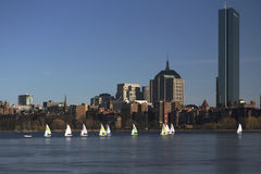 Boston Skyline, sail boats and Prudential Bld. in winter on half frozen Charles River, Massachusetts, USA Royalty Free Stock Photography
