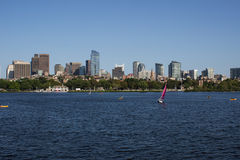 Boston Skyline and Sailboats along Charles River Stock Photo