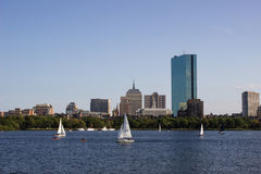 Boston Skyline and Sailboats along Charles River Royalty Free Stock Images