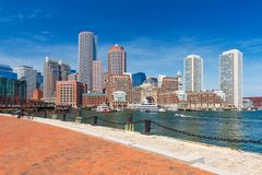 Boston skyline in summer day, USA. Boston skyline in summer day, skyscrapers in downtown against the blue sky, view from harbor, Massachusetts, USA royalty free stock photo