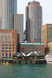 Boston skyscrapers above old fishing shacks Royalty Free Stock Photography