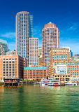 Boston skyscrapers in financial district, view from harbor on downtown, Massachusetts, USA Stock Photography