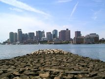 Boston Stone Pier. An old stone pier jutting towards the downtown skyline from East Boston Royalty Free Stock Photos