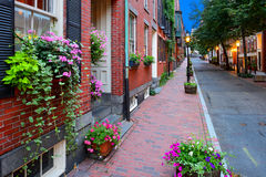 Boston Streetscape at Night. Brick sidewalk and narrow street in Beacon Hill Boston. Flowers on window box and planters Stock Photography
