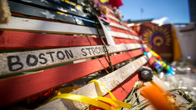 Boston Strong - Boston Marathon Memorial. A makeshift memorial to the victims of the Boston Marathon Bombing on April 15, 2013.  It features a piece of wood Royalty Free Stock Photo