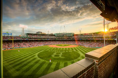Boston Strong Fenway Sunset. The sun is setting over Fenway Park's field which has been mowed with a B Strong to honor the victims and survivors of the Boston Stock Photos